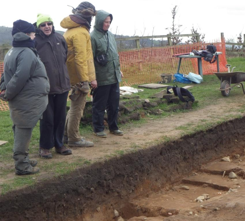 Discussions over a series of post holes and linear stone features